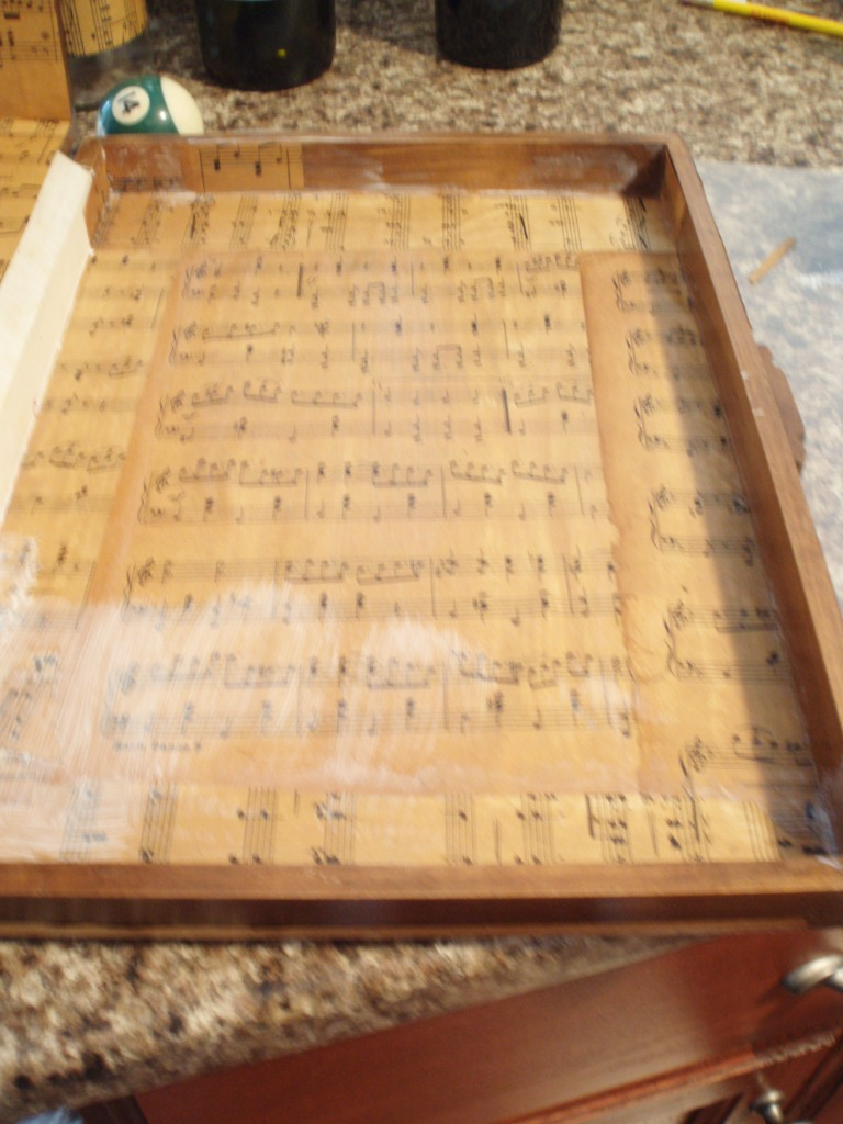 A thin layer of Mod Podge on the box and the Sheet Music